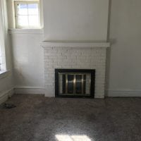 Original fireplace and mantle left in place